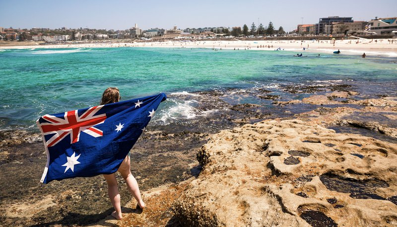 Intro Travel Oz Intro Group Tours Girl With Australia Flag In Bondi Beach