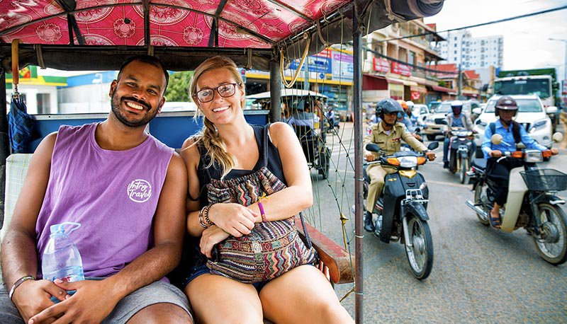 Intro Travel Vietnam And Cambodia Intro Group Tours Couple In Tuk Tuk Phnom Penh