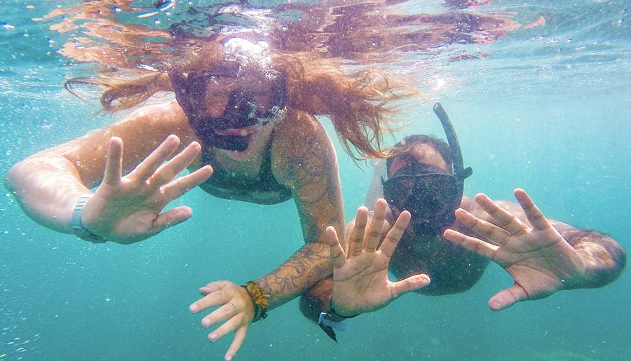 Intro Travel Vietnam And Cambodia Intro Group Tours Couple Snorkelling In Koh Rong