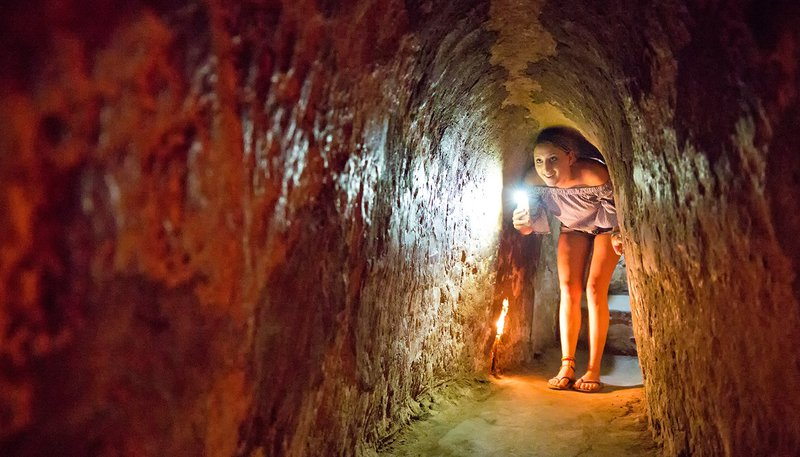 Intro Travel Vietnam And Cambodia Intro Group Tours Exploring The Cu Chi Tunnels