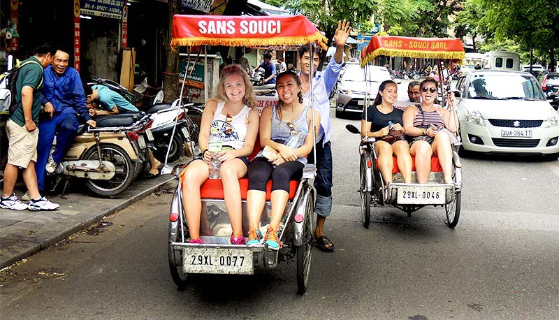Intro Travel Vietnam And Cambodia Intro Group Tours Girls in Rickshaw Hanoi
