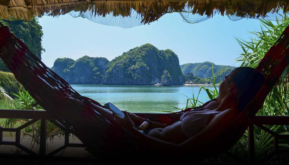 Intro Travel Vietnam And Cambodia Intro Group Tours Girl Chilling In Hammock Freedom Island